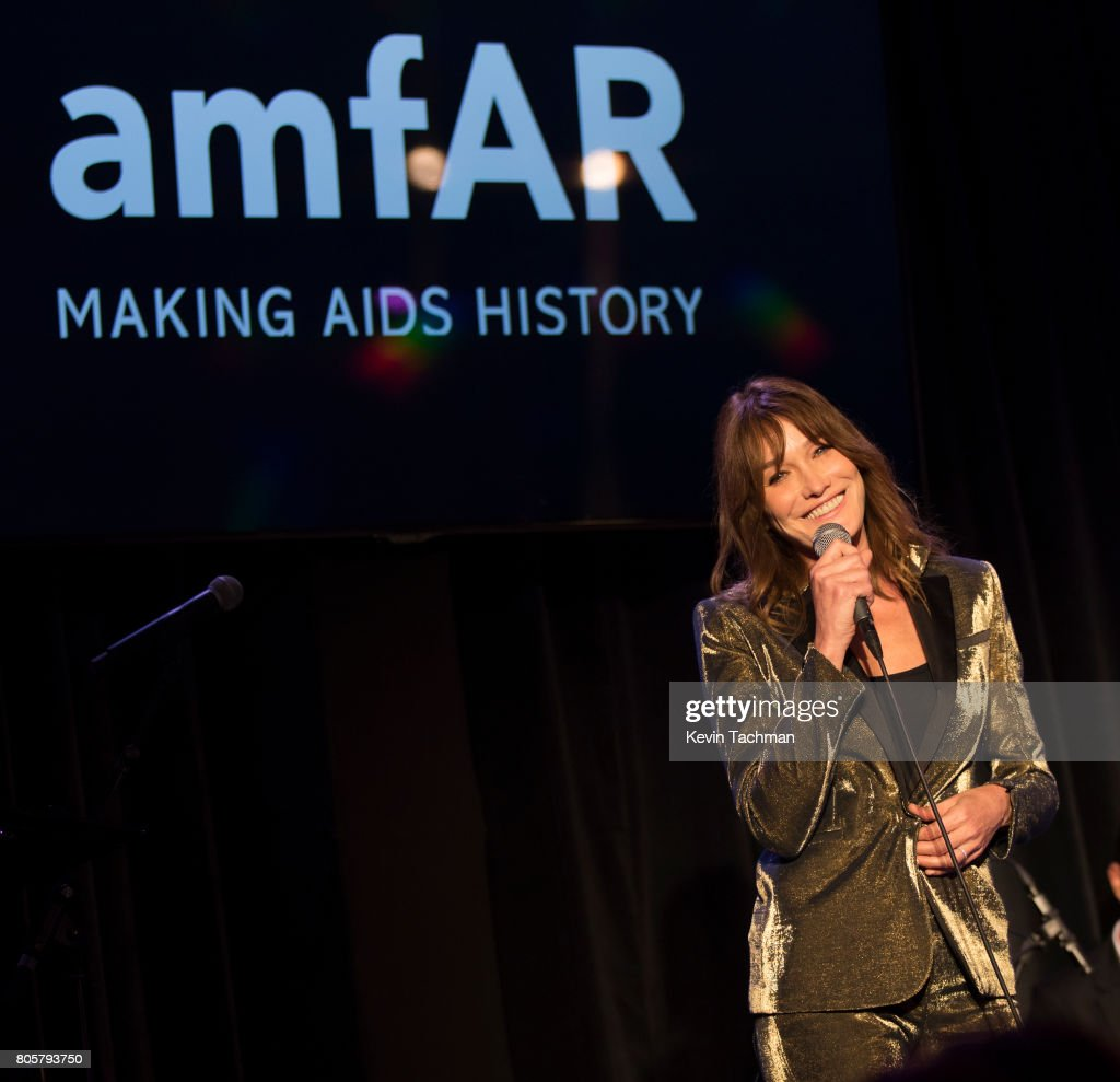 Carla Bruna takes the stage at amfAR Paris Dinner at Le Petit Palais on July 2, 2017 in Paris, France.