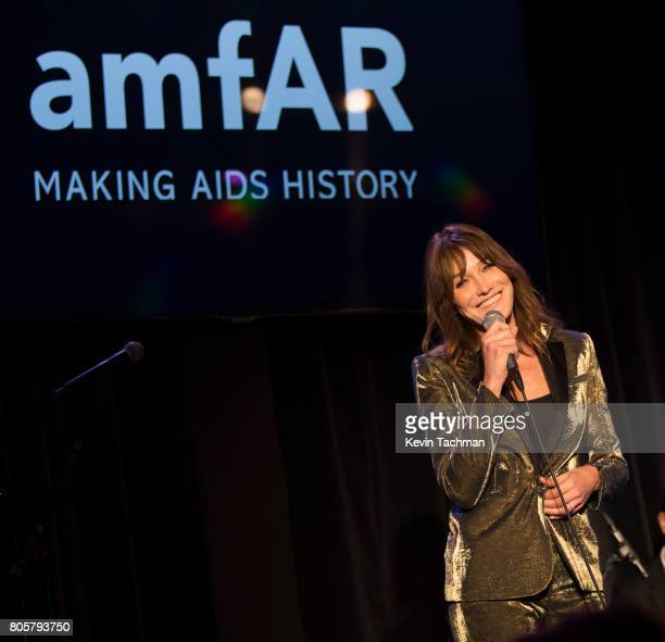 Carla Bruna takes the stage at amfAR Paris Dinner at Le Petit Palais on July 2 2017 in Paris France