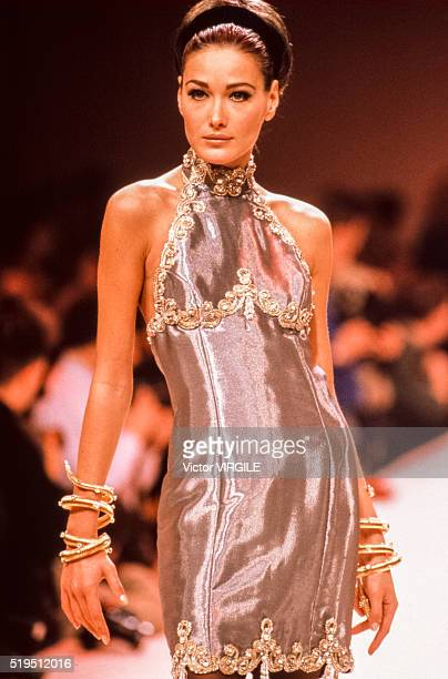 Carla Bruni walks the runway at the Chloe Ready to Wear Fall/Winter 19911992 fashion show during the Paris Fashion Week in March 1991 in Paris France
