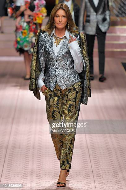 Carla Bruni walks the runway at the Dolce Gabbana Ready to Wear fashion show during Milan Fashion Week Spring/Summer 2019 on September 23 2018 in...