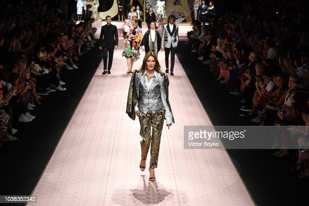 Carla Bruni walks the runway at the Dolce Gabbana show during Milan Fashion Week Spring/Summer 2019 on September 23 2018 in Milan Italy