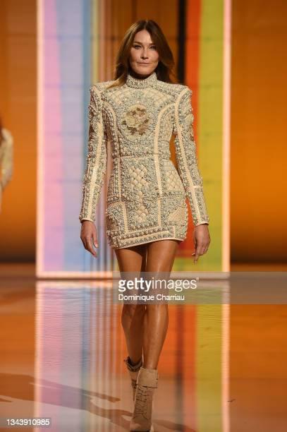Carla Bruni walks the runway during the Balmain Festival V02 Womenswear Spring/Summer 2022 show as part of Paris Fashion Week at La Seine Musicale on...
