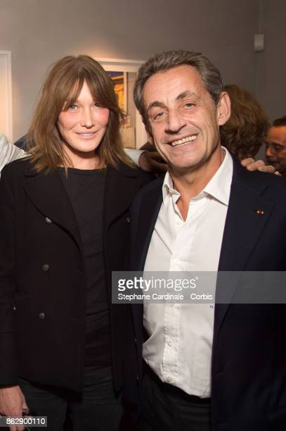 Carla BruniSarkozy and Former French President Nicolas Sarkozy attend the Simon Bocanegra and Philippe Morillon Exhibition at la Galerie Du passage...
