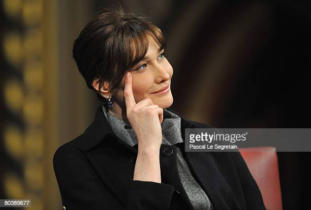 Carla BruniSarkozy attends as French President Nicolas Sarkozy delivers a speech to the UK parliament on March 26 2008 in Westminster Palace London...