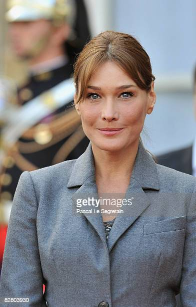 Carla BruniSarkozy attends Pope Benedict XVI's visit in the courtyard of the Elysee Palace September 12 2008 on his arrival in Paris France The four...