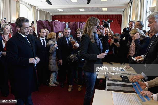 Carla BruniSarkozy casts her vote as Former French President Nicolas Sarkozy stand on March 23 2014 in Paris France Municipal elections are taking...