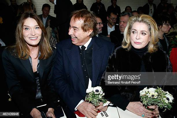 Carla BruniSarkozy Gilles Dufour and Catherine Deneuve attend the Jean Paul Gaultier show as part of Paris Fashion Week Haute Couture Spring/Summer...