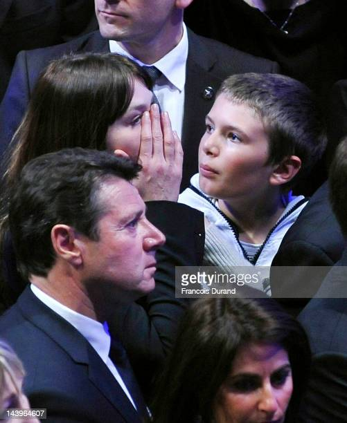 Carla BruniSarkozy listens to Rightwing incumbent candidate Nicolas Sarkozy speech after the second round results of the French Presidential...