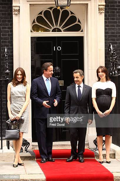 Carla BruniSarkozy Prime Minister David Cameron French President Nicolas Sarkozy and Samantha Cameron pose for a photograph on the steps at Downing...