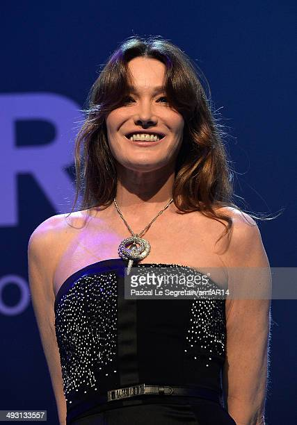 Carla BruniSarkozy speaks onstage during amfAR's 21st Cinema Against AIDS Gala Presented By WORLDVIEW BOLD FILMS And BVLGARI at Hotel du CapEdenRoc...