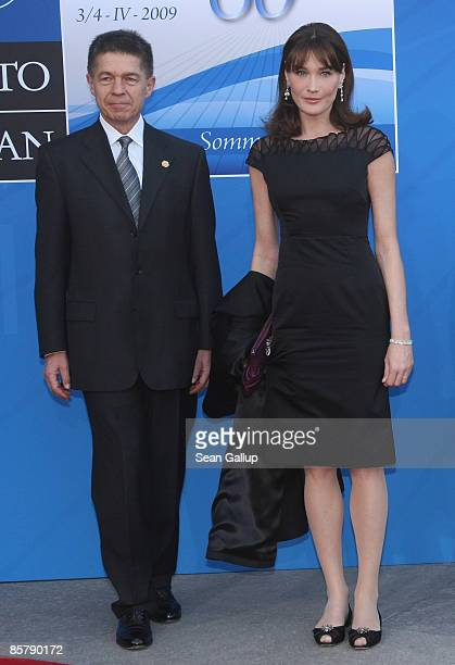 Carla BruniSarkozy wife of French President Nicolas Sarkozy and oachim Sauer husband of German Chancellor Angela Merkel arrive at the opening of the...