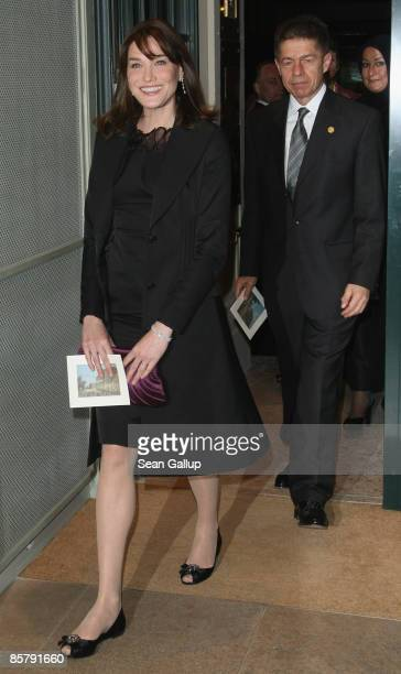 Carla BruniSarkozy wife of French President Nicolas Sarkozy and Joachim Sauer husband of German Chancellor Angela Merkel arrive for the spouses'...