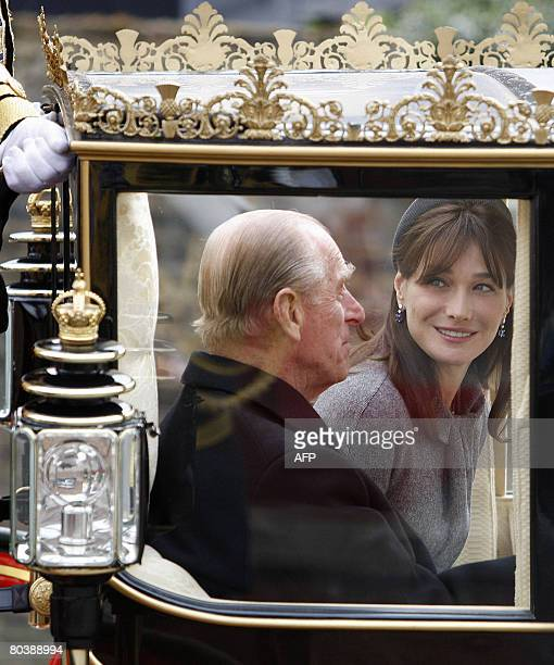 Carla BruniSarkozy wife of French President Nicolas Sarkozy and Britain's Prince Philip travel in a Carriage through the streets of Windsor west of...