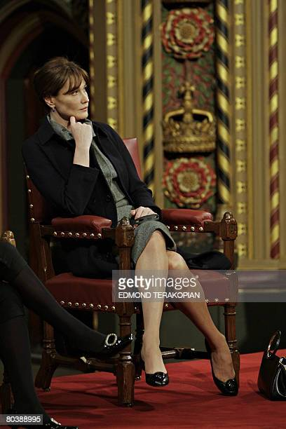 Carla Bruni-Sarkozy, wife of French President Nicolas Sarkozy, listens to her husband addressing the Palace of Westminster in London, on March 26,...