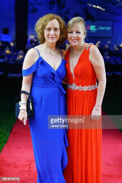 Carla Capek and guest attend the 22nd Annual Hamptons Heart Ball on June 23 2018 in Southampton New York