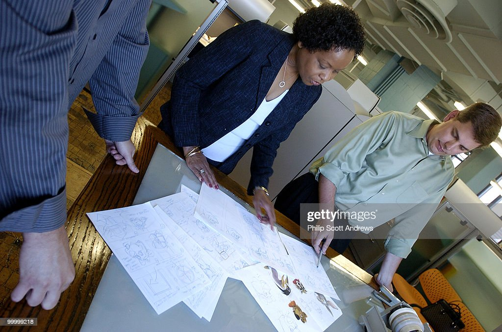 Carla Cary of the Army Family Advocacy Program, and John Tobiason of the Government Printing Office look over sketches for an animated show made for the children of soldiers deployed to Iraq.