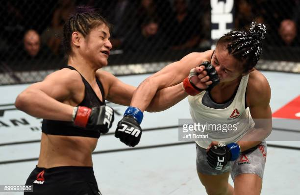 Carla Esparza and Cynthia Calvillo trade punches in their women's strawweight bout during the UFC 219 event inside TMobile Arena on December 30 2017...