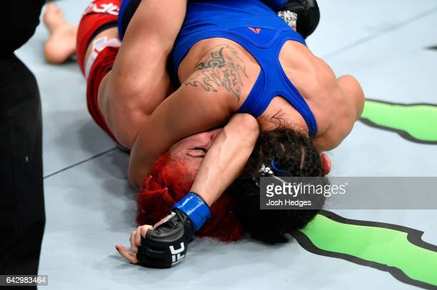 Carla Esparza attempts to submit Randa Markos of Iraq in their women's strawweight fight during the UFC Fight Night event inside the Scotiabank...