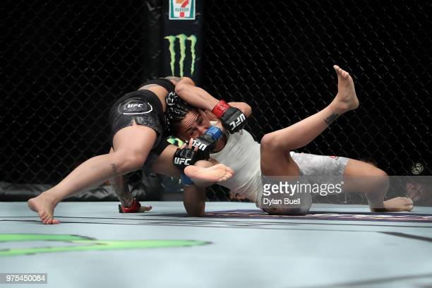 Carla Esparza attempts to take down Claudia Gadelha of Brazil in the second round in their strawweight bout during the UFC 225 Whittaker v Romero 2...