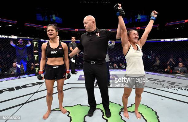 Carla Esparza celebrates her unanimousdecision victory over Cynthia Calvillo in their women's strawweight bout during the UFC 219 event inside...