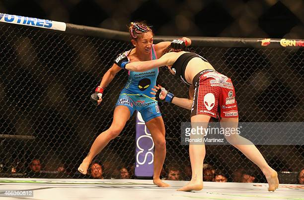 Carla Esparza fights with Joanna Jedrzejczyk in the Women's Strawweight bout during the UFC 185 event at American Airlines Center on March 14 2015 in...