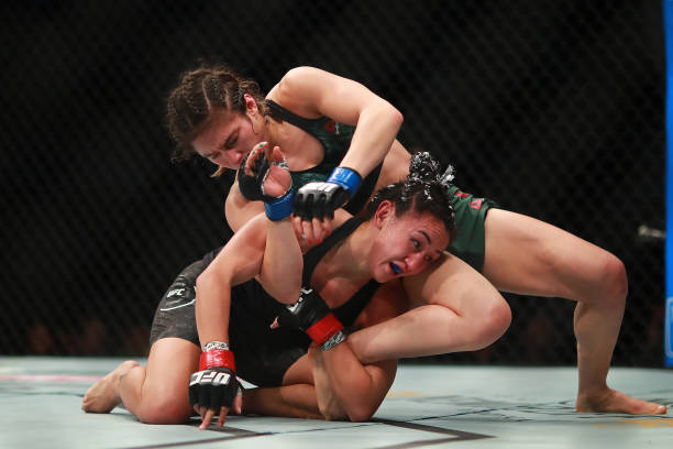 Carla Esparza of Mexico punches Alexa Grasso in their women's strawweight bout during UFC Fight Night event at Arena Ciudad de Mexico on September...