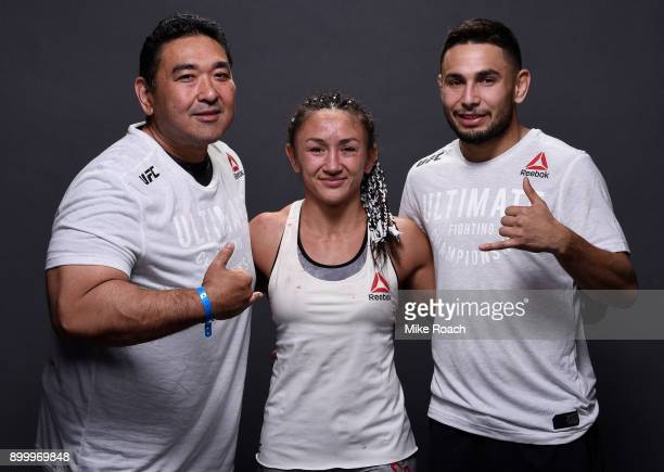 Carla Esparza poses for a portrait backstage with her team after her victory over Cynthia Calvillo during the UFC 219 event inside TMobile Arena on...