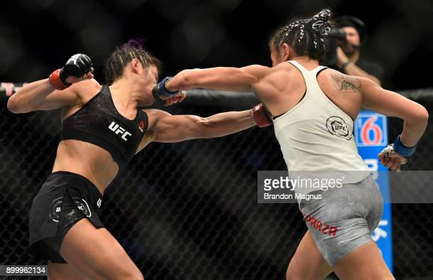 Carla Esparza punches Cynthia Calvillo in their women's strawweight bout during the UFC 219 event inside TMobile Arena on December 30 2017 in Las...