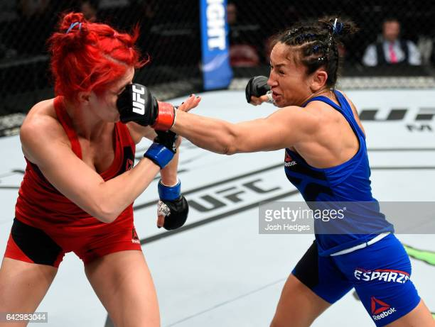Carla Esparza punches Randa Markos of Iraq in their women's strawweight fight during the UFC Fight Night event inside the Scotiabank Centre on...