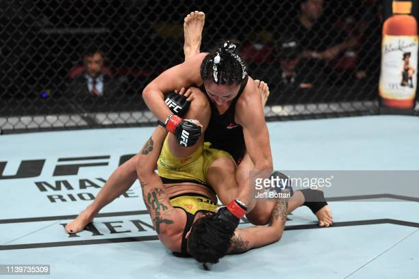 Carla Esparza punches Virna Jandiroba of Brazil in their women's strawweight bout during the UFC Fight Night event at BBT Center on April 27 2019 in...