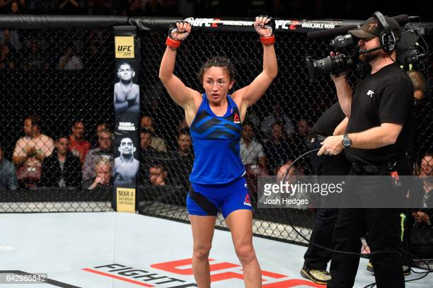 Carla Esparza raises her hands after finishing three rounds against Randa Markos of Iraq in their women's strawweight fight during the UFC Fight...