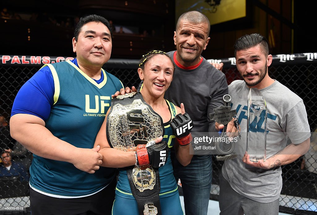 Carla Esparza takes a photo with her team after submitting Rose Namajunas in the third round and becomes the first UFC women's srawwieght champion during The Ultimate Fighter Finale event inside the Pearl concert theater at the Palms Casino Resort on December 12, 2014 in Las Vegas, Nevada.