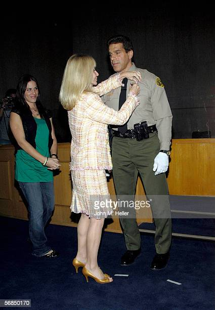 Carla Ferrigno pinned the Reserve Deputy Sheriff's badge on her husband Lou Ferrigno during graduation ceremonies from the Los Angeles County Deputy...