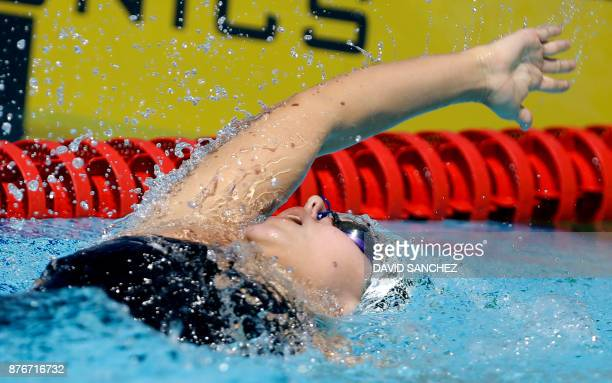 Carla Gonzalez of Venezuela competes in the women's 100 meters backstroke swimming qualifying event during the XVIII Bolivarian Games in Santa Marta...