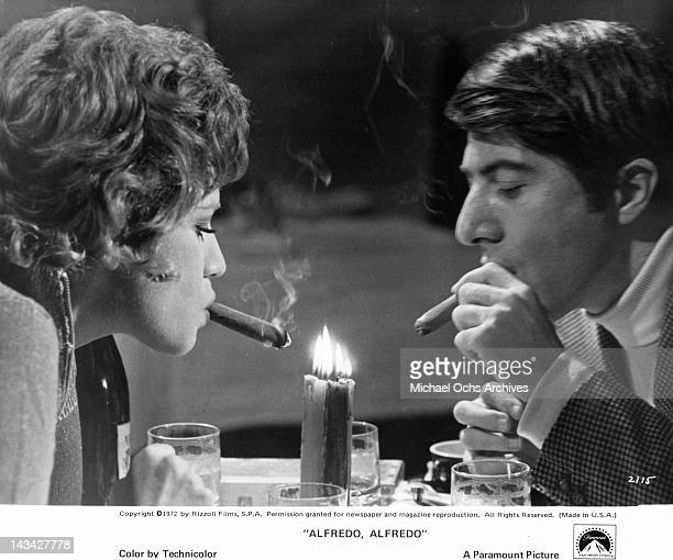 Carla Gravina and Dustin Hoffman enjoy an unusual after dinner smoke in a scene from the film 'Alfredo, Alfredo', 1972.