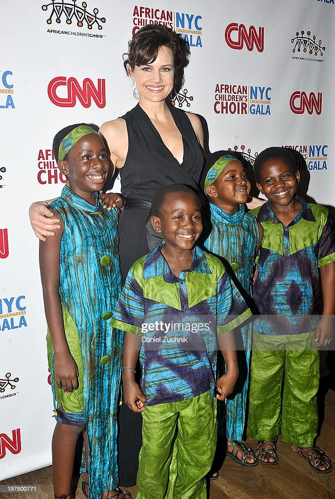 Carla Gugino and the African Children's Chior attend the 4th annual African Children's Choir Fundraising Gala at City Winery on December 3, 2012 in New York City.