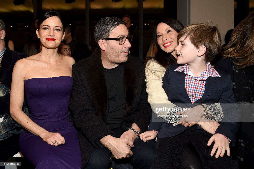 Carla Gugino, Jason Weinberg, Lucy Liu and Jasper Weinberg attend the Zac Posen Fall 2016 fashion show during New York Fashion Week at Spring Studios on February 15, 2016 in New York City.