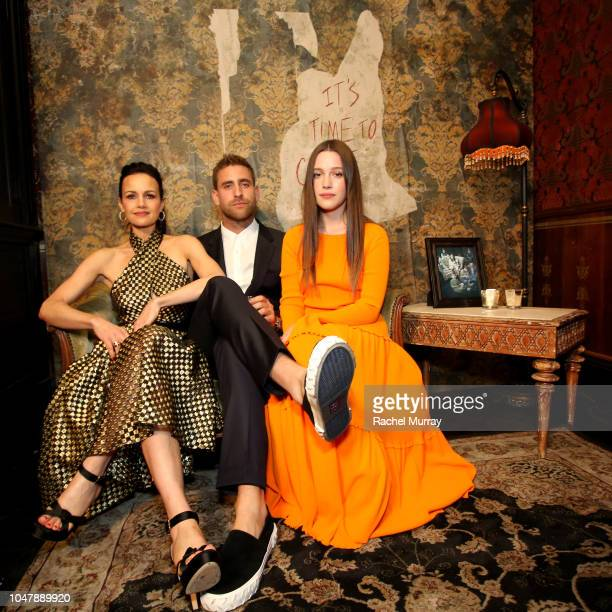 Carla Gugino Oliver JacksonCohen and Victoria Pedretti attend Netflix's The Haunting of Hill House Premiere afterparty at No Vacancy on October 8...