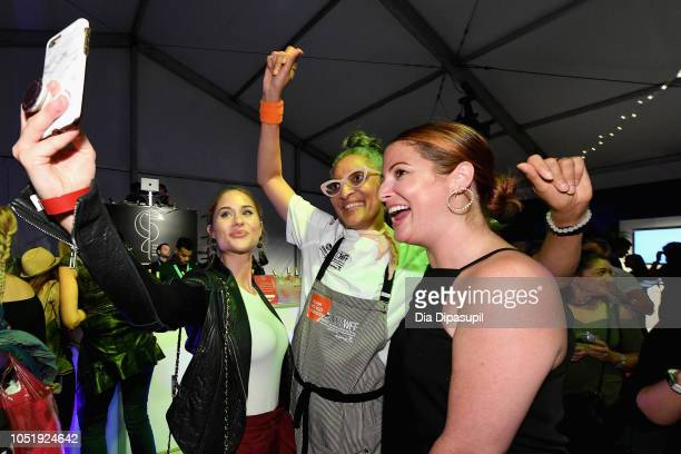 Carla Hall attends the Food Network Cooking Channel New York City Wine Food Festival presented by Capital One Supper Is Served A Tasting Featuring...