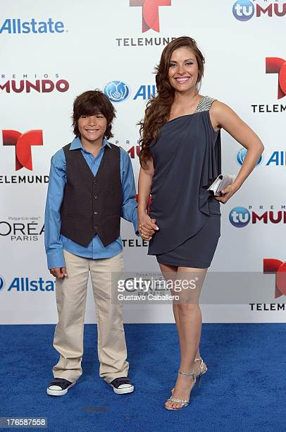 Carla Hernandez and son arrive for Telemundo's Premios Tu Mundo Awards at American Airlines Arena on August 15 2013 in Miami Florida
