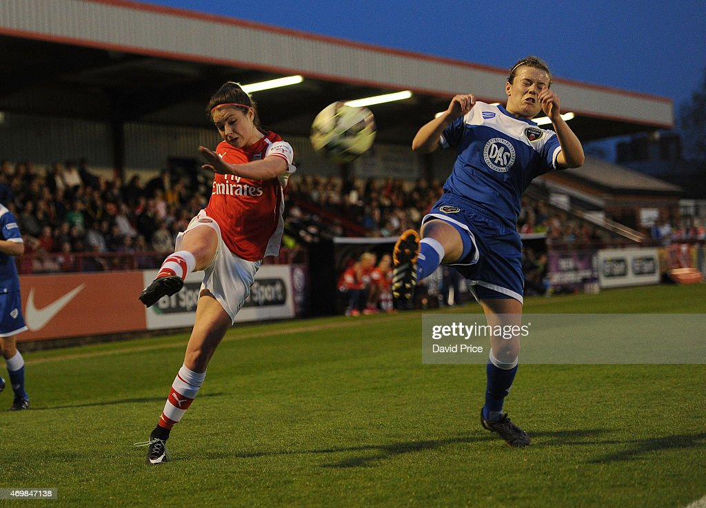 Carla Humphrey of Arsenal Ladies crosses under pressure from Hayley Ladd of Bristol during the WSL match between Arsenal Ladies and Bristol Academy at Meadow Park on April 15, 2015 in Borehamwood, England.