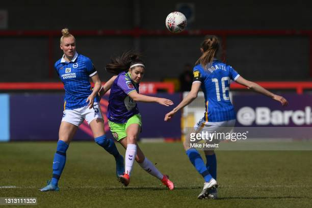 Carla Humphrey of Bristol City Women is chalenged by Danique Kerkdijk and Ellie Brazil of Brighton during the Vitality Women's FA Cup Fourth Round...