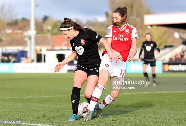 Carla Humphrey of Bristol City Women is challenged by Lisa Evans of Arsenal during the Barclays FA Women's Super League match between Arsenal and...