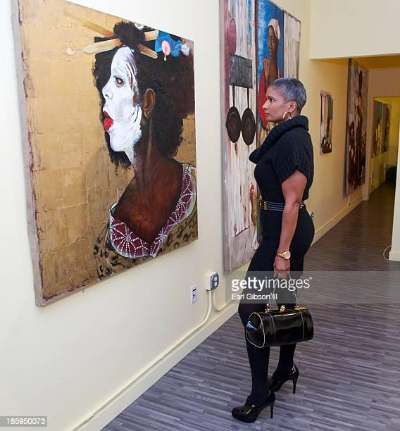 Carla Kemp views a painting by artist Chaz Guest at Quinn Studios on October 25 2013 in Santa Monica California