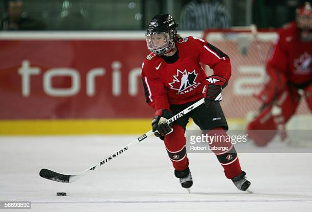 Carla MacLeod of Canada controls the puck during the final of the women's ice hockey against Sweden during Day 10 of the Turin 2006 Winter Olympic...
