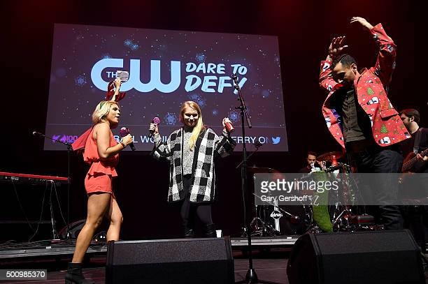 Carla Marie and Anthony Halwagy onstage with a guest at Z100's Jingle Ball 2015 Z100 CocaCola All Access Lounge Show at Hammerstein Ballroom on...