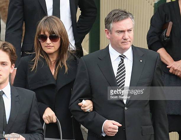 Carla McGuire and Eddie McGuire look on as the coffin is carried from the church after the funeral service for John McCarthy at St Mary's Star of the...