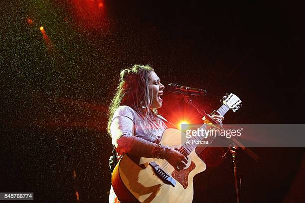 Carla Morrison performs in the rain as part of Celebrate Brooklyn at Prospect Park Bandshell on July 9 2016 in New York City
