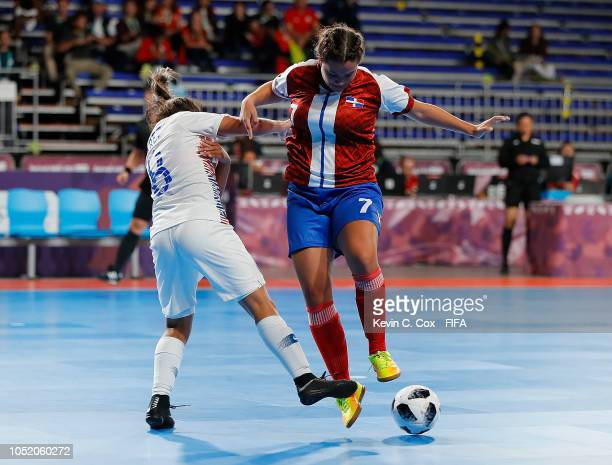 Carla Perez of Chile challenges Maria Ditren of the Dominican Republic in the Women's Futsal Group D match between the Dominican Republic and Chile...
