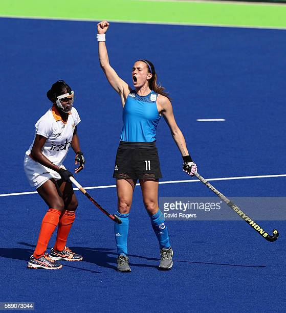 Carla Rebecchi of Argentina celebrates after scoring a goal during the Women's pool B hockey match between Argentina and India on Day 8 of the Rio...